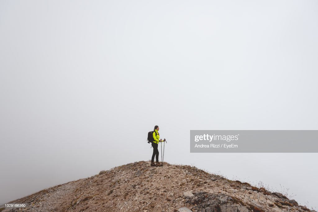 Rear View Of Man Standing On Rock : Foto stock