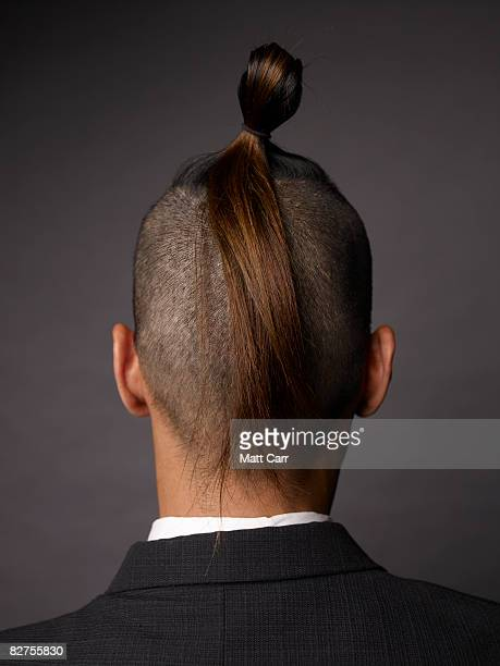 rear view of man with mohawk - ponytail stock pictures, royalty-free photos & images