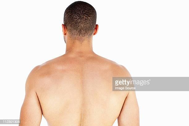 rear view of man's back - sin camisa fotografías e imágenes de stock
