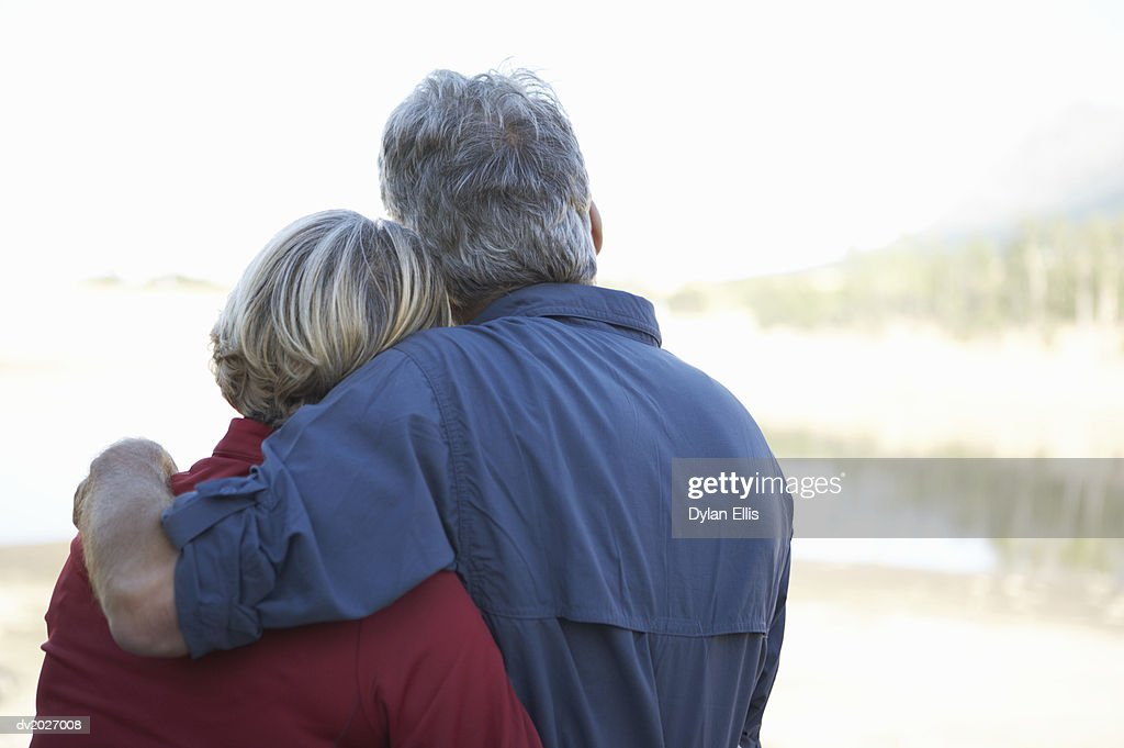 Rear View of Mature Couple Embracing : Stock Photo