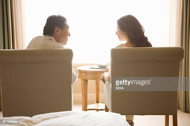 Rear view of mature couple talking