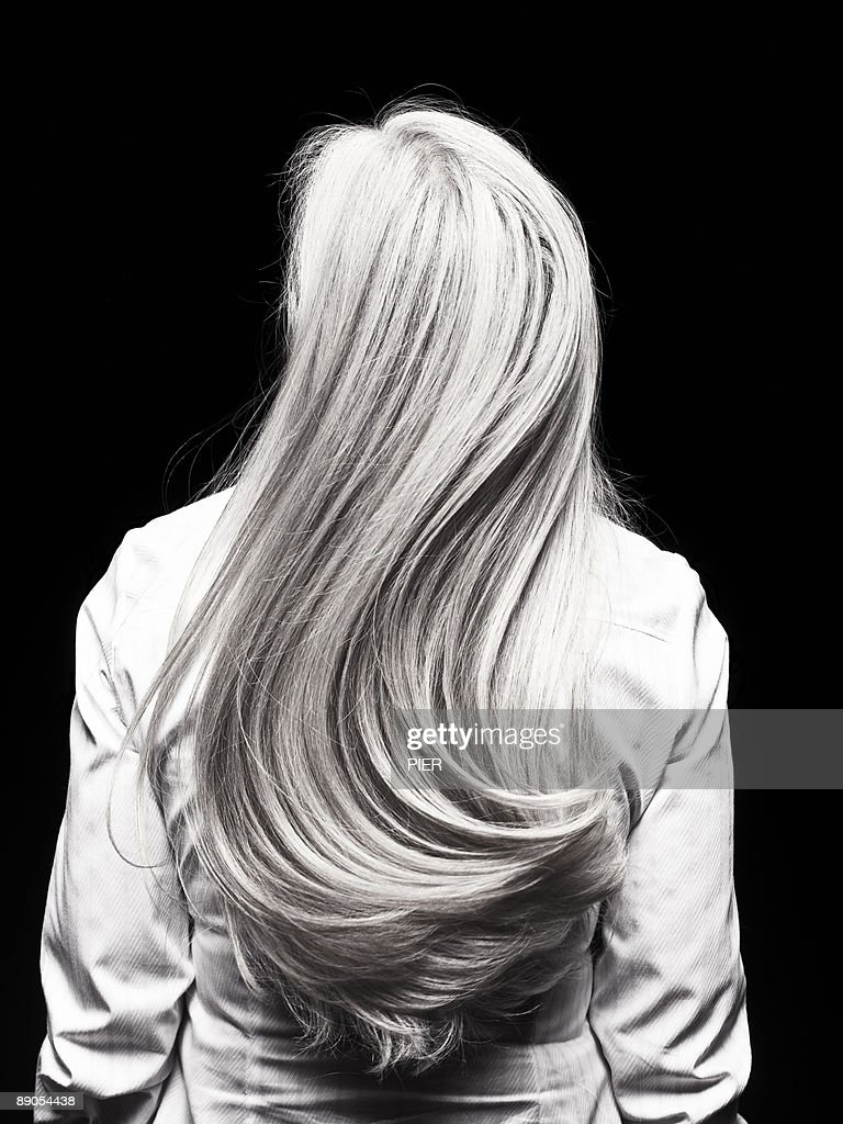 Rear view of mature womans silver head of hair : Stock Photo