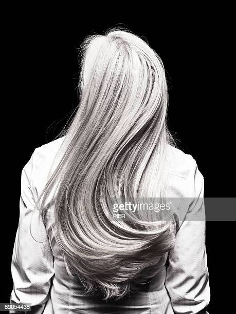 Rear view of mature womans silver head of hair