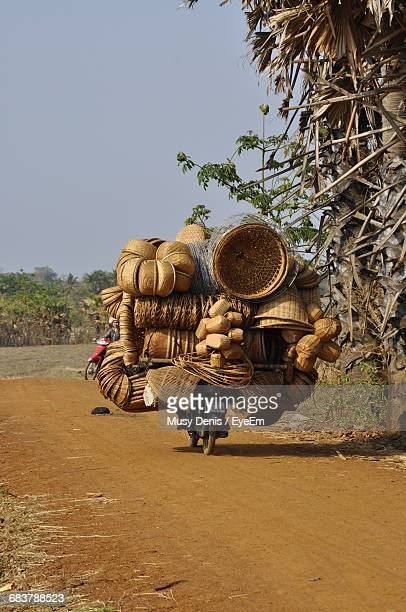 Rear View Of Merchant Transporting Baskets