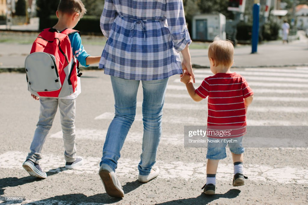 Rear View Of Mother With Children : Stock Photo