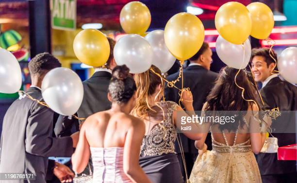 rear view of multi-ethnic teenagers at prom - prom stock pictures, royalty-free photos & images
