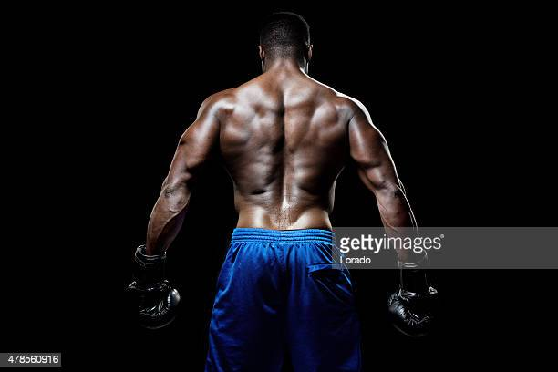 rear view of muscular black male - black male bodybuilders stock photos and pictures