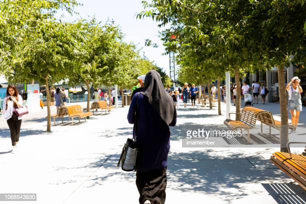 Rear view of  muslim woman in burka in the city