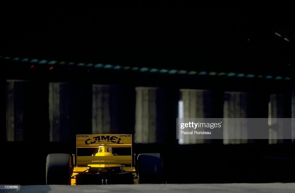 Rear view of Nelson Piquet of Brazil as he enters the tunnel in his Lotus Judd during the Monaco Grand Prix at the Monte Carlo circuit in Monaco. Piquet retired from the race after a collision with Dallara Ford driver Andrea de Cesaris of Italy. \Mandatory Credit: Pascal Rondeau/Allsport