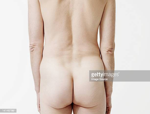 rear view of nude man - bare bottom stock pictures, royalty-free photos & images