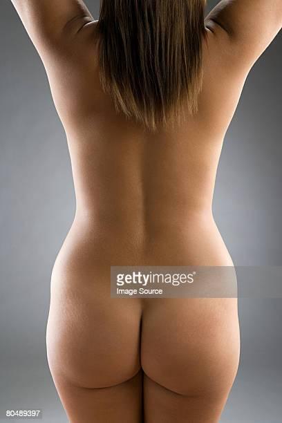 rear view of nude woman - fesses femme gros plan photos et images de collection