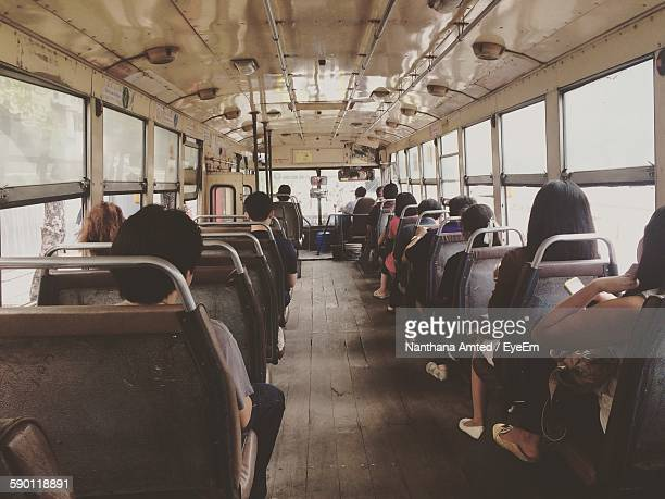 Rear View Of Passengers Sitting In Bus