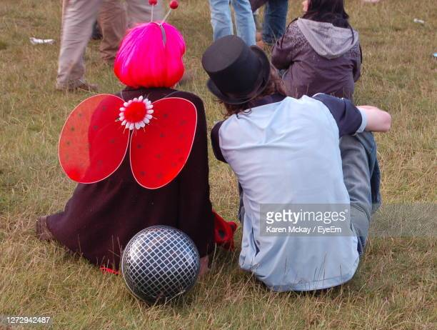 rear view of people at a festival - karen mckay stock pictures, royalty-free photos & images