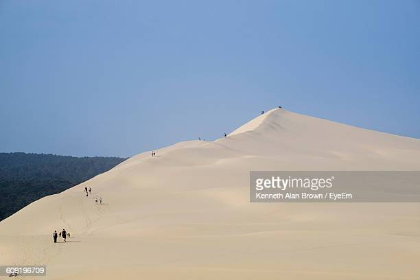 rear view of people at dune of pilat against clear sky - gironde stock pictures, royalty-free photos & images