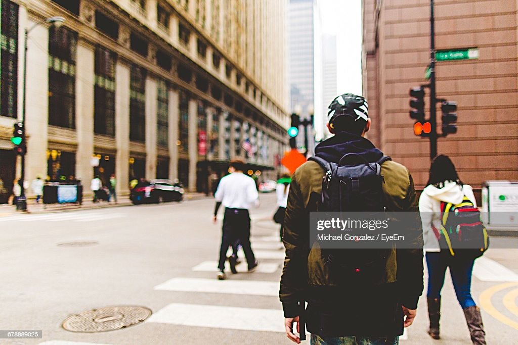 Rear View Of People Crossing Street In Chicago : Stock Photo