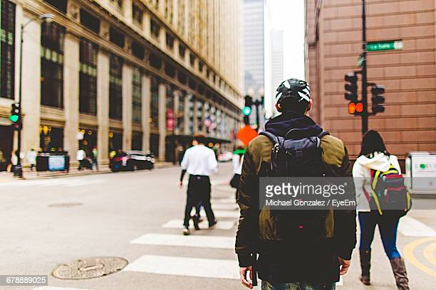 Rear View Of People Crossing Street In Chicago