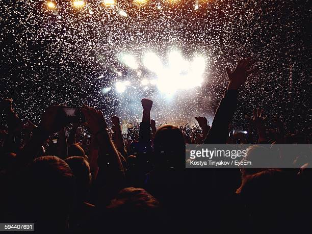 rear view of people enjoying music concert - concert stock pictures, royalty-free photos & images