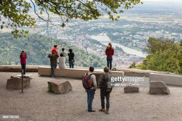 rear view of people enjoying view of city from observation point - baden württemberg stock-fotos und bilder
