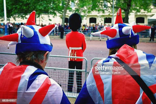 rear view of people in british flags by street during celebration - trooping the colour 2016 stock pictures, royalty-free photos & images