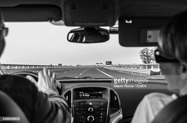 rear view of people in car - vehicle mirror stock photos and pictures