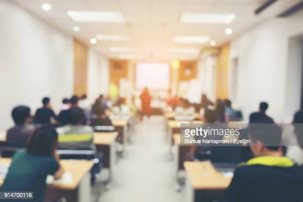 rear view of people in classroom - classroom stock photos and pictures