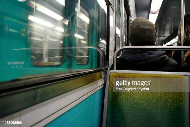 rear view of people in train - subway train stock pictures, royalty-free photos & images