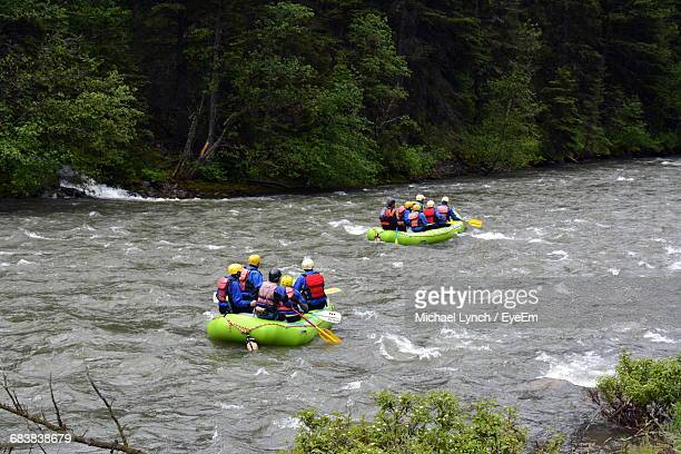Rear View Of People Rafting In Gallatin River