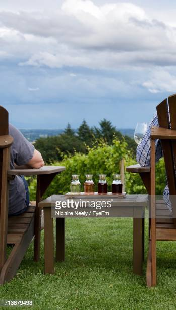 Rear View Of People Relaxing Outdoors