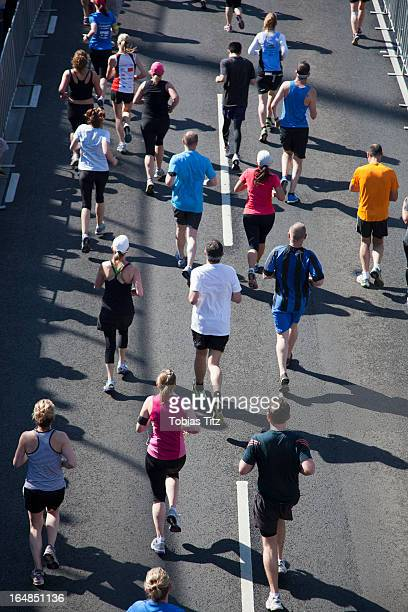 Rear view of people running in a marathon