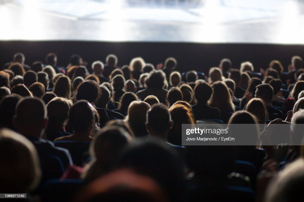 Rear View Of People Sitting In Auditorium During Seminar : Stock Photo