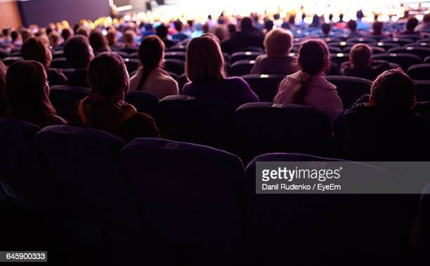 Rear View Of People Sitting In Auditorium