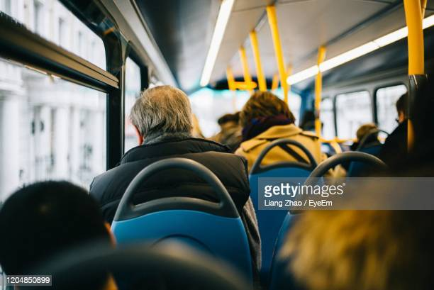rear view of people sitting in bus - public transport stock pictures, royalty-free photos & images