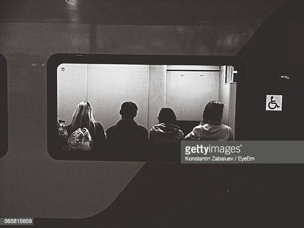 rear view of people sitting in train by window - nizhny novgorod oblast stock photos and pictures