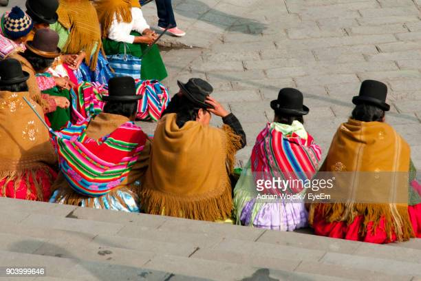 rear view of people sitting on steps - bolivia stockfoto's en -beelden