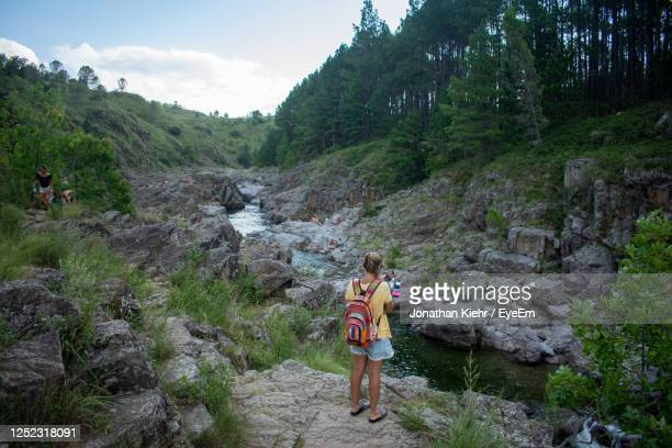 rear view of people standing on mountain - cordoba argentina stock pictures, royalty-free photos & images