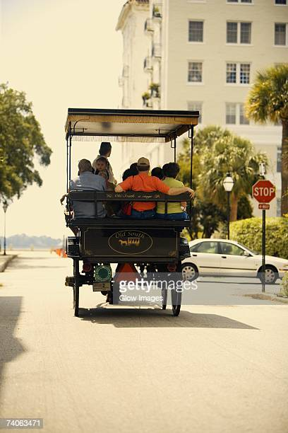 Rear view of people traveling in a horse cart, Savannah, Georgia, USA