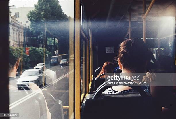 Rear View Of People Traveling In Bus