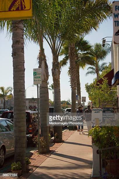 rear view of people walking on a city street, old town san diego, california, usa - old town san diego stock pictures, royalty-free photos & images