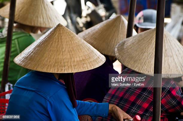 Rear View Of People Wearing Asian Style Conical Hat