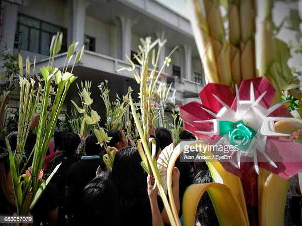 rear view of people with palm branches during palm sunday - palm sunday stock pictures, royalty-free photos & images
