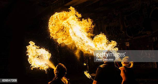 Rear view of performers fire breathing
