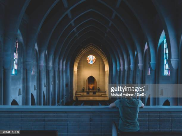 Rear View Of Person In Church