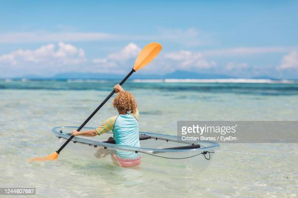 rear view of person in sea against sky - bortes stock pictures, royalty-free photos & images
