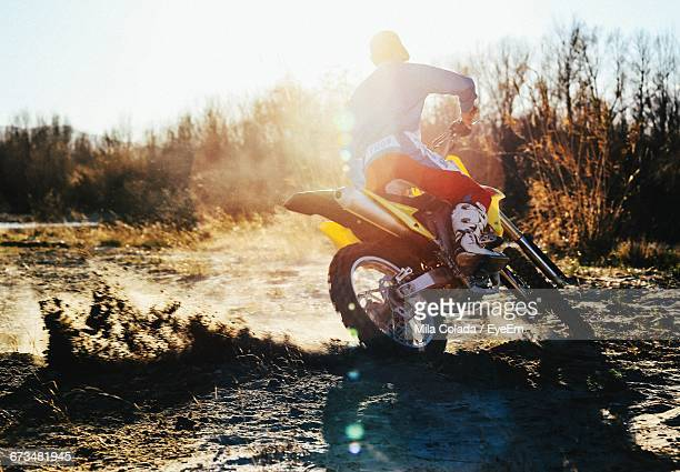 Rear View Of Person Riding Motorbike