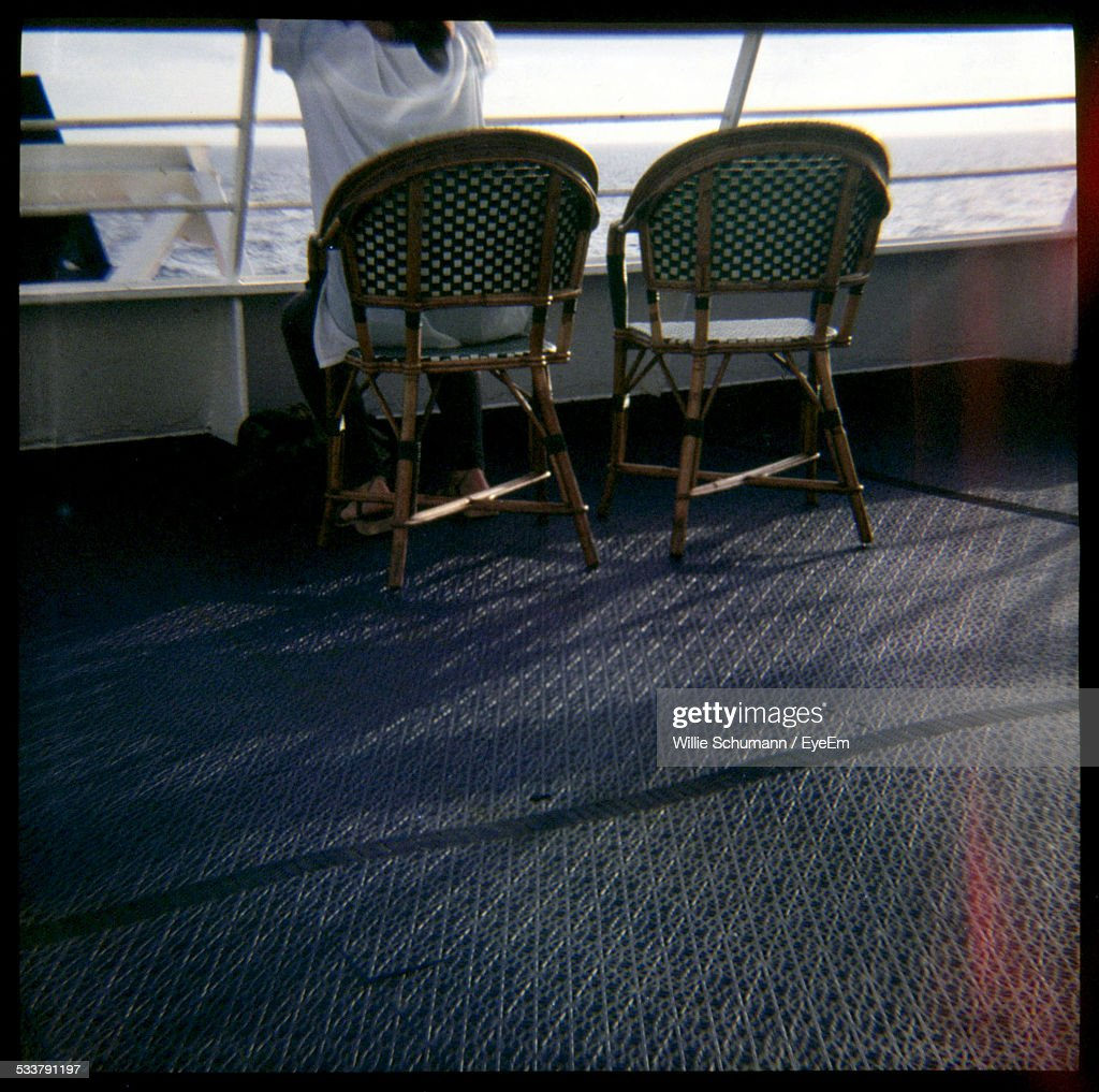 Rear View Of Person Sitting On Deck Of Ship : Foto stock