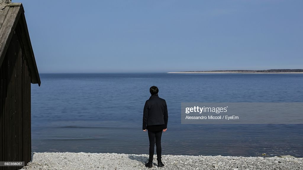 Rear View Of Person Standing At Seaside : Stock Photo