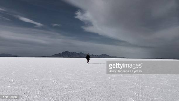 Rear View Of Person Walking On Bonneville Salt Flats