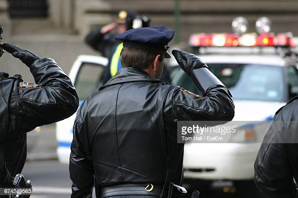 Rear View Of Police Officers
