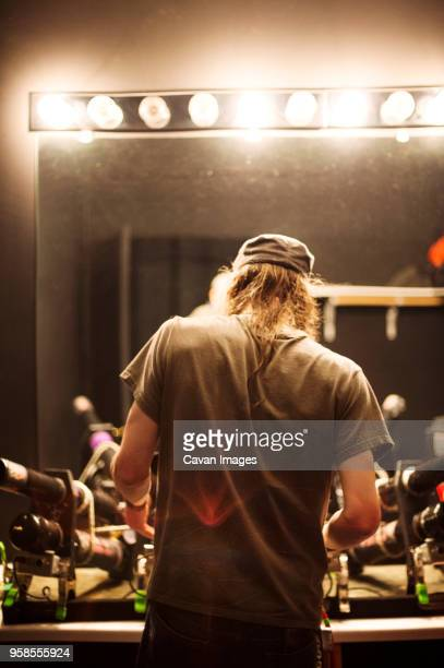 rear view of rock musician preparing for music concert - backstage stock pictures, royalty-free photos & images