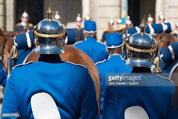 Rear View Of Royal Guards In Parade